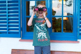 Boy with binoculars outside family-friendly hotel Dorset