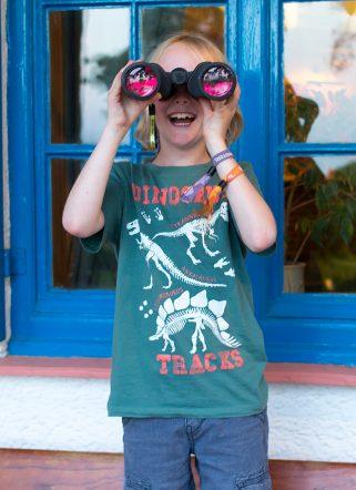 Boy with binoculars outside family-friendly hotel Dorset