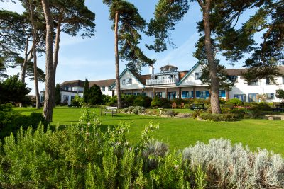 Exterior view of Knoll house and grounds, one of the places to stay in Dorset
