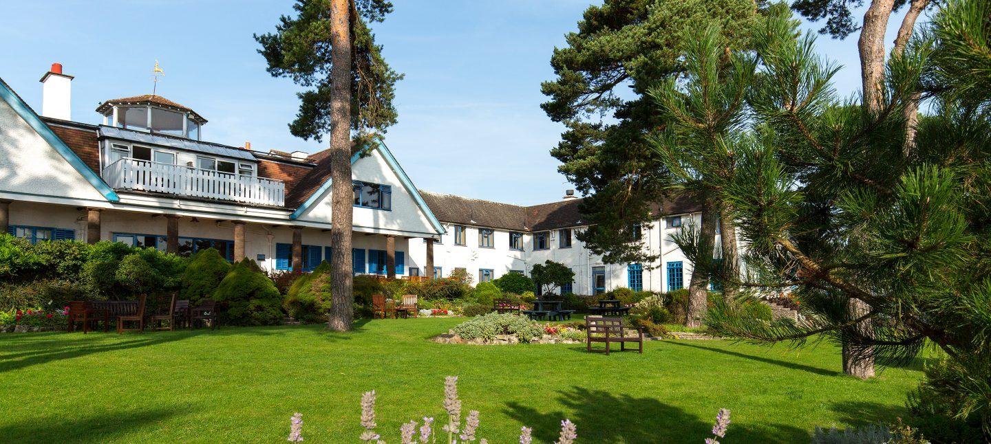 Exterior view of Knoll House Dorset hotel with sea views