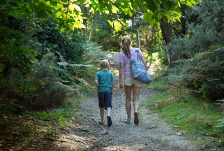 A mother and child walk the hotel grounds at Knoll House in Dorset