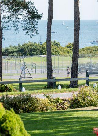 Tennis court facility looking through to Dorset golf course