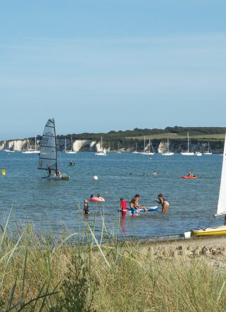 Sailing and watersports activities in the bay of a Dorset beach hotel