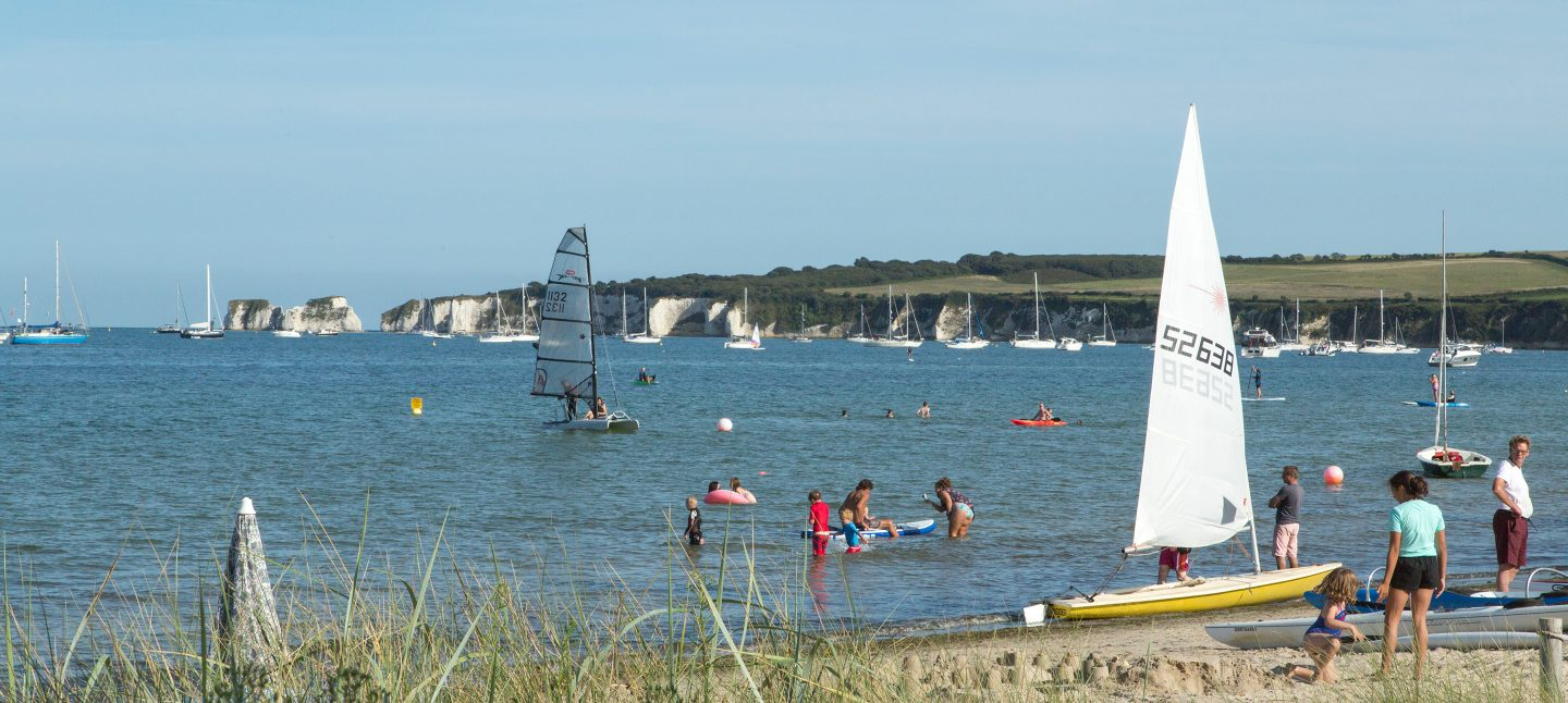 View of the Dorset coast and watersport activities from one of the best beaches in Dorset