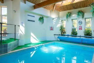 Indoor swimming pool at Knoll House spa hotel in Dorset