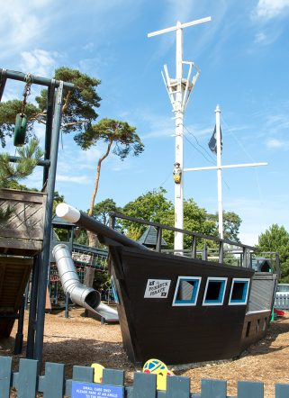 The outdoor adventure play area at Knoll House in Dorset, with a pirate ship and zip line