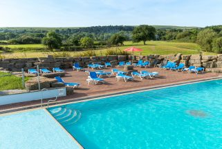 Outdoor pool and loungers within spa hotel Dorset