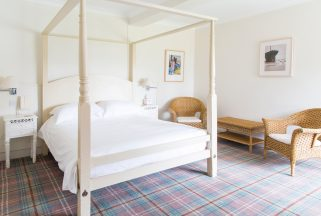 A four-poster bed in on of the rooms at Knoll House hotel in Dorset