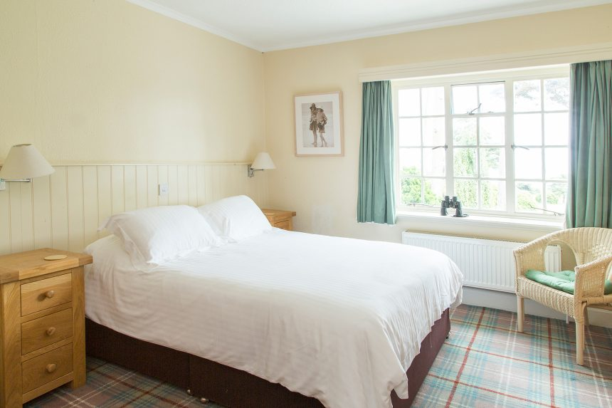 Bright and clean bedroom in Dorset hotel with sea views