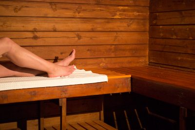 A woman relaxes in the sauna on a spa day at Knoll House in Dorset.