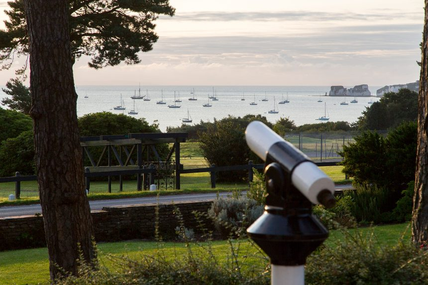 Telescope looking out from the conference onto Studland Bay, Dorset