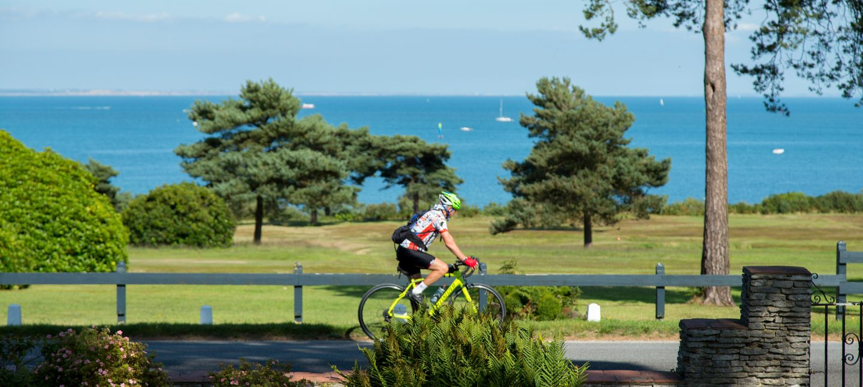 A man enjoying a seaside Dorset cycle route past Knoll House