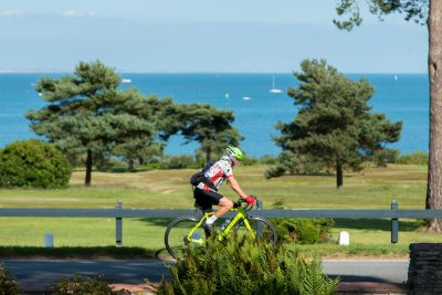A man enjoying a seaside Dorset cycle route past Knoll House